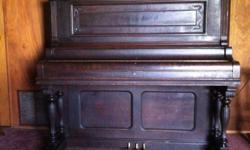 Harrington upright piano,early American, dark wood, very ornate.