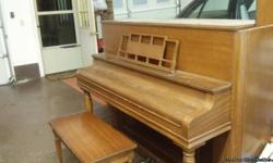 Piano for sale. 3 keys down and note top off but not missing.