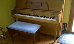 Upright piano, oak finished, Premiere brand, great condition, needs tuning. Bench with storage for music books included. Excellent for starters, church youth group area, club house den, etc. Pick up yourself.