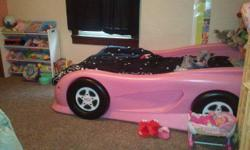 """TWIN PINK RACE CAR/SPORTS CAR BED! This is a Little Tikes Race/""""Sports Car TWIN Bed."""" The mattress and box spring are NOT included. We bought it brand new for $350.00 on Walmart.com. It's $299 on walmart.com now. The bed is in EXCELLENT shape. My daughter"""