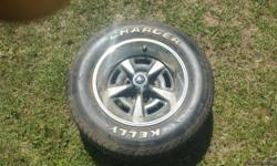 I have a set of 4, 1960 1970 pmd pontiac rally wheels with 235/60r15 kelly charger tires mounted to them. One wheel has center cap missing and the outer ring a little dinged up which you can find on ebay.