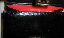 NEW black Polizzio pocketbook. Size 9w x 7 1/2 h