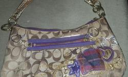 This is a used REAL POPPY COACH BAG that is in very good shape. Has pockets inside and out. Colors of Coach purse is purple and tan with sequences with a little ware but nothing else. this certain coach purse is not made no more by coach. This product