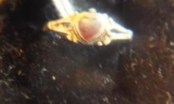 This is a pinky ring that was given at the birth of a daughter that died out after the War. It is set in coin silver and the bloodstone is heart shaped. Size is 3 and in excellent shape . These are rare as most have been melted