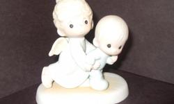 Misc. retired Precious Moments figurines with original boxes. In mint condition.