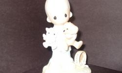 Misc. retired Precious Moments figurines in original boxes. Mint condition.