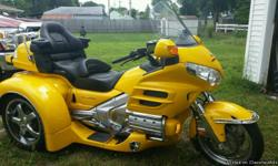 This Pearl Yellow 2010 Honda Goldwing Motor Trike is virtually new with only 781 miles. It is in perfect condition in every way. It's always been garage-kept and never rained on. It has plenty of added on features and accessories such as, a luggage rack,