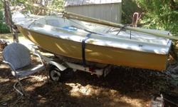 1974 O'Day sailboat 14' in great condition for sale. Has pretty white sails trimmed in gold, all ropes, trolling motor, 4 life jackets, rudder, anchor and more.. Storage compartments as well has center board.. Trailer in great shape almost new