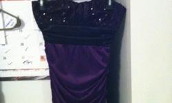Purple and black dress strapless. Top has sequins. Size small. Worn once. Asking $20, OBO. Call 681-212-9933 for details. Meet in Morgantown.