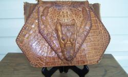 This purse was bought about 1948 before they put a restrain on shooting aligators.