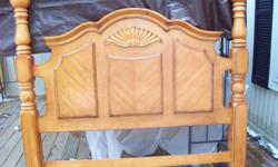 Queen size Bed.Beautiful Pine Headboard, foot board & side boards in excellent condition. Purchased at Bob's Discount furniture in 2005 for spare bedroom. Seldom used.Must sell.