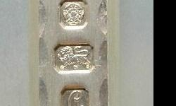 This is a beautiful sterling silver ingot from my private collection. It is an original Limited edition Quen Elizabeth Silver Jubilee Anniversary solid silver boullion ingot from 1977. The front has diamond cuts along the edges which are a signature