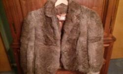 Genuine...Authentic ....2 rabbit fur jackets...one, a beautiful gray color...the other a rich brown/tan color....one zips in front ..the other buttons....rich lining..150.00 for both. Looks new!!!