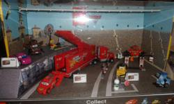 """This is a very rare beautiful impossible to find 2ft lighted Pixar Cars2 store display. Display has motion sensors which run by D batteries. Motion sensors light up top of display. Approximately 12""""x24""""x16 and 16 lbs. This was a store"""