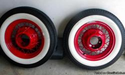 I have (2) 1935 Ford 16x4 original Wire wheels with New Coker WW Radial tires. These also have the hub re-inforcement rings and chrome center caps. These were sandblasted, then powdercoated bright red. These are great for the fronts. Tire size is 5.50-R16