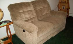 Wall hugging reclining love seat (both sides recline seperately). No stains,tears, or snags like new 100.$ CALL --
