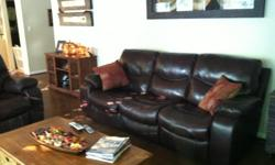 Dark brown, leather recling sofa & love seat. Purchased from Ashley Furniture in December. Paid $2300. Like new condition.