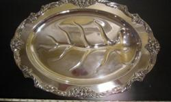(taking offers) here i am selling a classic and High detailed reed and barton silver plated dish. This is one of the more exspencive food platters you can get because of the details and size. you can research it yourself it is a reed and barton 1674 as