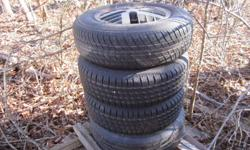 4 RIMS THAT CAME OFF A GRAND AM AND 3 ALMOST NEW TIRES. SIZE-185-75-14 .