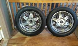 4 Goodyear Eagle GT II tires in good condition with American Racing rims also in good condition. Asking $200 OBO