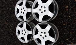 "Set of silver 18"" X 8"" Chevy Cobalt rims for $375 or better offer."