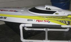 RC gas boat added on parts like clutch,waterpump ,tuned pipe exhaust. have all original parts plus extras. ready to run. or trade for brushless boat lipos and charger with all parts worth $1100 will sell for $450.