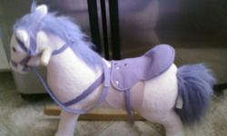Pink and purple. Complete with stirrups. Mint condition. Please email me @ candi685@gmail.com