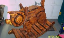 Made from solid pine wood. Base 42 inches length by 16 inches width. Height of pig is 36 inches high by 8 inches width. Very strong and durable.