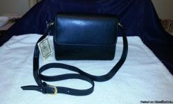 ROSETTI shoulder Bag approx. 7x8. Beautiful black faux leather shoulder bag for the woman on the go. This has multiple compartments and numerous slots for credit cards. Adjustable strap for women of all heights. Credit card compartment snaps shut so if