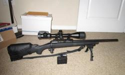 "Has new cordura case. New, Millett, 4x16x50mm side focus scope with lighted reticle.  1 in 10 twist heavy 20"" barrel, 320 rounds of new FMJ ammo.  Call 806-282-5140, Canyon, Tx. $800.00 cash only.  10 round custom mag shown is $100.00 extra"