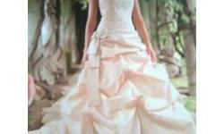 Savvi Formalwear Bridal & Tuxedo Gown for sale. The dress is white, not off white, pearl, etc. It has silver embelishments. Original price is $900. Sale price is $450 or a reasonable close offer. Worn only once, in great condition. (Dress bag
