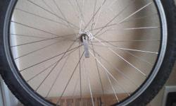 24 X 1.95 schwinn front rim tire put on as bonus good condition selling 9am - 6pm no shipping cash only.