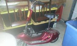 Red Scoot N Go Battery operated scooter perfect for that neighborhood teen. Needs new battery and lots of over looked love.