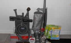 Sentria Vacuum Cleaner, Powerful vacuum used two times. Comes with 13 hepafiltration bags, a dozen different attachments plus booklet and video manual. Can wash floors or rugs. Paid $1200.00. Will take $425.00 or best offer. If