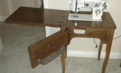 Elgin sewing machine, Model 2468. Machine has the following capabilities: Straignt sewing, darning, monograming, zigzagging, embroidering, blind stitch hemming, making button holes and sewing on buttons. Machine has not be used in past 10 years and may