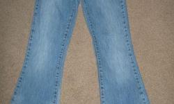 """I am selling a pair of Silver Jeans, size 27/31. Comes from a smoke free home! Asking $35.00 obo Style: """"77"""", low rise, stretch flare Wash: Light-medium blue w/ factory fading and distress Tag size: 27/31 Actual Measurements: Waist 30"""" Inseam 31"""" Leg"""