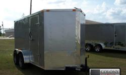 """New 6x12 tandem axle enclosed trailer standard features include: 1.) V-nose front (extra space) w/ solid wall construction 2.) 24"""" atp stoneguard front 3.) Atp stoneguard strip up the point of v-nose 4.) Medium duty 2500 lb. Rear ramp door w/ ramp"""