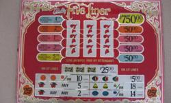 I have 5 of these slot machine pay out glass items. ( I think it is called pay out). Take a look and let me know. I have had them for so many years, but I do not gamble, so I don't know exactly. Anyhow, 2 of them are in pretty good shape, one of them in
