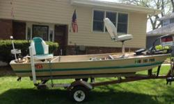 12 Foot Sears Game Fisherman with Trailer. Has the following: 120 Tanka gas motor, 37 lb. Thrust foot controlled Trolling motor, Eagle Cuda 300 Fish Finder, Deep Cycle Battery (2 years old), Running Lights, two Life Jackets, Oar, Battery box, and