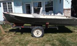 10ft aluminum boat. Water tight with one folding seat. Used primarily for duck hunting. Have carried 2 adults, decoys, and 100lb black lab onto the river in this boat.