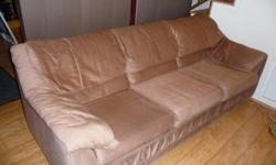 """Light brown sofa with queen size pull-outbed. Very good condition. Mounted on large casters,suitable forhard-wood floors and carpeting. 84"""" long. Client must provide truck for pick up."""