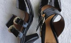 Originally $85 +/- Womens black leather heel slip on sandals. Barely worn. No tears or scratches. Size 7.5 Will negotiate.