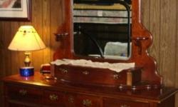 """Lovely Dresser with lots of drawers, beautiful ornate mirror with sconces and a jewelry drawer The dresser measures 65 wide by 18 deep by 35 tall. It has 12 drawers with brass handles - 8 are 14"""" wide by 15"""" deep -4 are 21.5"""" wide by 15"""" deep The mirror"""