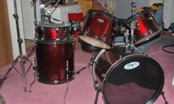 5 piece drumset red sparkle finish. 14X5 snare, 8x12 & 9x13 mounted toms, 16x16 Floor tom, 16x22 bass. Snare stand, 3 cymbal stands, hi hat, bass pedal & throne, & extras. Almost new.