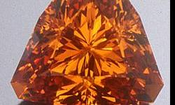 This is an incredible Orange Mandarin Garnet. Material this color and clarity is very rare and highly in demand. The brilliance is so noticeable, even in dim lighting. This baby is a 10.5mm trillion and weighs 5.54 Cts. This stone is all natural and
