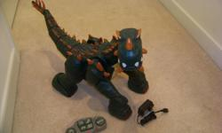 remote control dinosauer.like new.comes with charger.great christmas gift.contact me 898-0003
