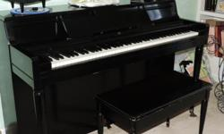 Black Spinet piano .. has bench to match .Good condition Will need tuning.
