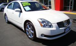 This Nissan Maxima is one of the cleanest, sharpest, most stylish cars on the lot! Take a look at it's warm beige leather interior; it's metallic and uniquely stylized console/dash setups - unlike anything you've seen anywhere else! A powerful yet