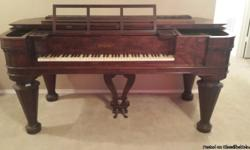 This handsome square grand piano was built by Chickering of Boston during the Civil War era. Chickering was the first piano manufacturer in America. This piano is made of Brazilian Rosewood, with real ivory keys and is of the massive Empire Revival style.