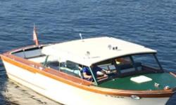 GET READY for the summer with a classic. STANCRAFT. Built in 1971; only a few of this design remain. Good news: beautiful teak and mahogany wood. Better news: hull is fiberglass. Low maintenance with the look and feel of a wood boat. 10 ft beam. New twin